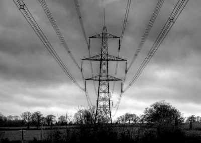 Marching Pylons - A Devon Village